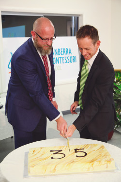 The Minister and Principal cut our birthday cake.